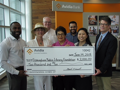 photo of Avidia Bank awarding 00 check to Foundation members and Trustees