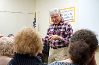 You can now borrow a DVD of our talk featuring Michael Dukakis! thumbnail Photo