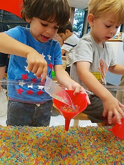 photot of two children playing in sensory bin