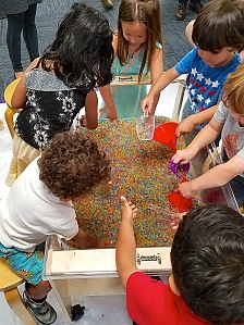 photo of children playing with sensory table