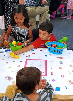 children looking at the I SPY table