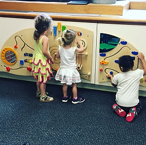 photo of children playing with interactive wall panel