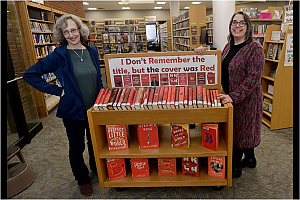 photo of FPL Librarians standing next to viral display